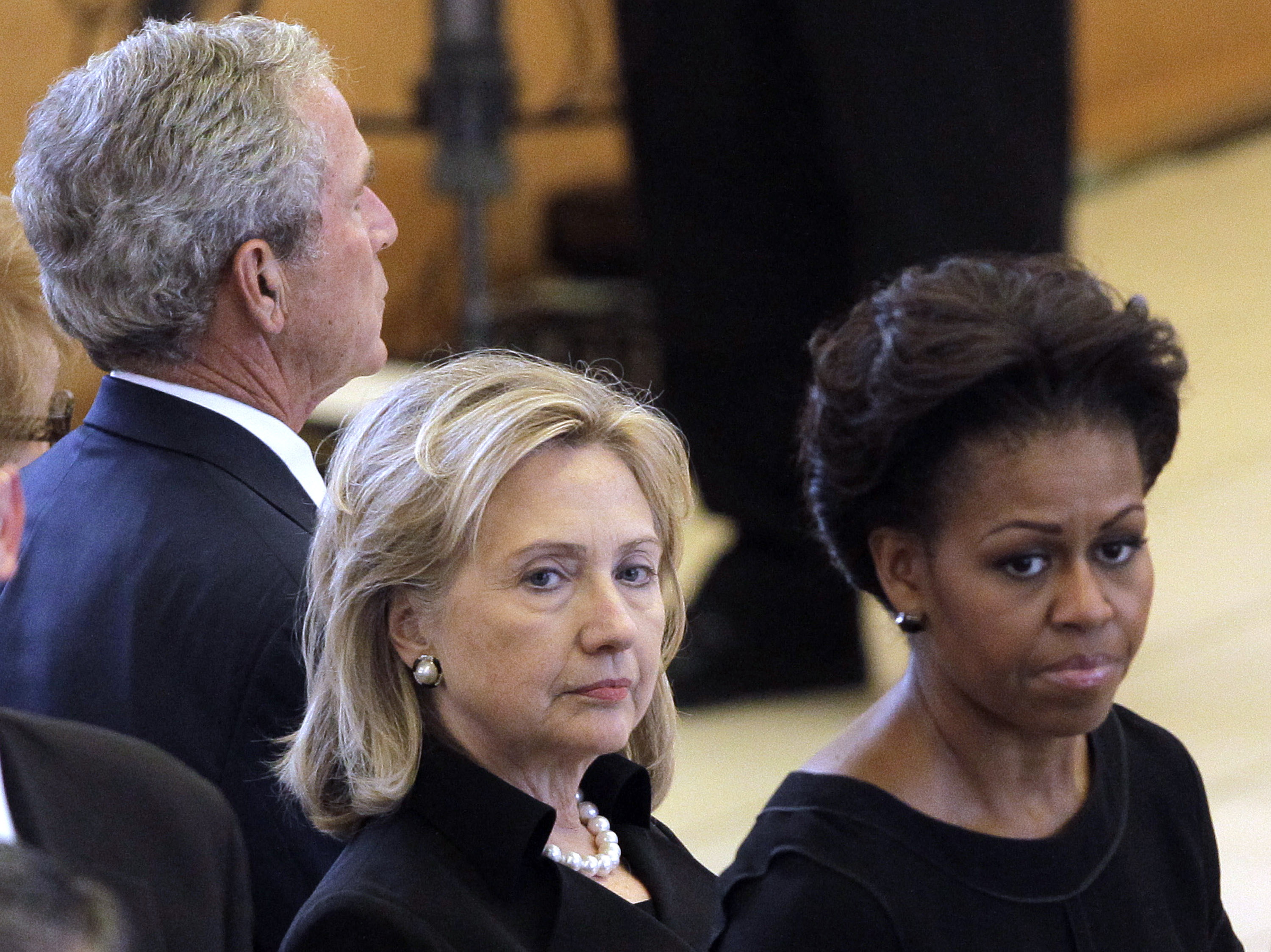 PALM DESERT, CA - JULY 12: (L-R) Former President George W. Bush, Secretary of State Hillary Rodham Clinton and first lady Michelle Obama attend the funeral for former first lady Betty Ford at St. Margaret's Episcopal Church July 12, 2011 in Palm Desert, California. Family, dignitaries, including first lady Michelle Obama, Secretary of State Hillary Rodham Clinton and former President Bill Clinton attended the service at St. Margaret's Episcopal Church, during which former first lady Rosalynn Carter and journalist Cokie Roberts presented eulogies for the outspoken Ford, who will be buried alongside her husband, former President Gerald R. Ford, in Grand Rapids, Michigan following a second service July 14. (Photo by Jae C. Hong-Pool/Getty Images)