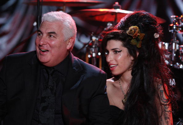 LONDON - FEBRUARY 10:  British singer Amy Winehouse sits with her father Mitch as they await news of her Grammy Award at The Riverside Studios for the 50th Grammy Awards ceremony on February 10, 2008 in London, England. Winehouse won 5 out of her 6 nominations including, record of the year, best new artist, song of the year, pop vocal album and female pop vocal performance.  (Photo by Peter Macdiarmid/Getty Images for NARAS)