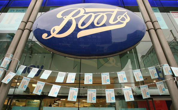 LONDON - MAY 04:  A large Boots the Chemist sign hangs over the fron entrance to their Oxford Street branch May 4, 2007 in London. Boots opened four of it's larger stores at 7am to allow customers to purchase the popular anti-aging serum.  (Photo by Peter Macdiarmid/Getty Images)