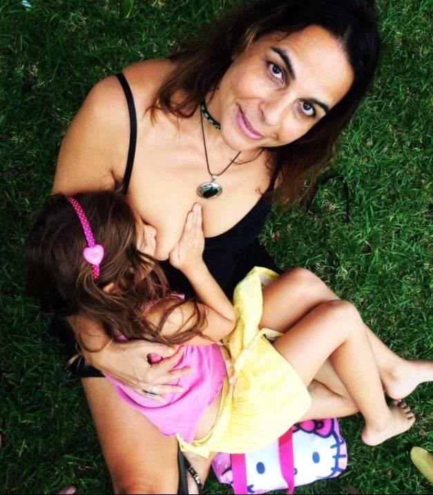 Maha Al Musa breatfeeding her six year old daughter