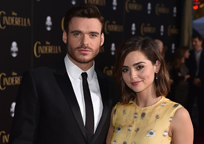 """HOLLYWOOD, CA - MARCH 01:  Actor Richard Madden (L) and Jenna Coleman attends the premiere of Disney's """"Cinderella"""" at the El Capitan Theatre on March 1, 2015 in Hollywood, California.  (Photo by Kevin Winter/Getty Images)"""