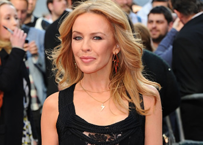 """LONDON, ENGLAND - MAY 21:  Kylie Minogue attends the UK Premiere of """"San Andreas"""" at Odeon Leicester Square on May 21, 2015 in London, England.  (Photo by Stuart C. Wilson/Getty Images)"""
