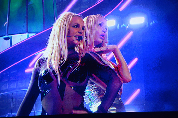 LAS VEGAS, NV - MAY 17:  Video footage of singer Britney Spears (L) performing with rapper Iggy Azalea is shown onstage during the 2015 Billboard Music Awards at MGM Grand Garden Arena on May 17, 2015 in Las Vegas, Nevada.  (Photo by Jeff Kravitz/BMA2015/FilmMagic)