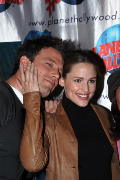 """UNITED STATES - FEBRUARY 13:  Ben Affleck and co-star Jennifer Garner put their heads together at Planet Hollywood, where Affleck hosted a screening of their new flick, """"Daredevil,"""" for children from the Memorial Sloan-Kettering Cancer Center's pediatric program.  (Photo by Richard Corkery/NY Daily News Archive via Getty Images)"""
