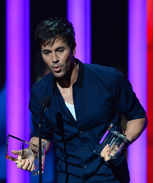 MIAMI, FL - APRIL 30: Enrique Iglesias onstage accepting award during the 2015 Billboard Latin Music Awards presented by State Farm on Telemundo at Bank United Center on April 30, 2015 in Miami, Florida. (Photo by Johnny Louis/FilmMagic)