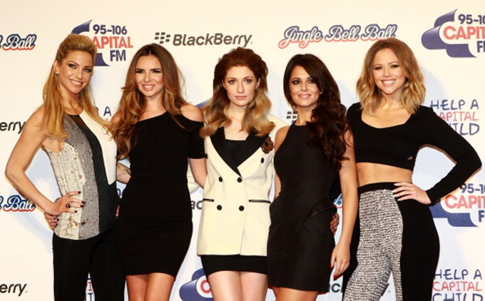 LONDON, UNITED KINGDOM - DECEMBER 09: Sarah Harding, Nadine Coyle, Nicola Roberts, Cheryl Cole and Kimberley Walsh of Girls Aloud attend the Capital FM Jingle Bell Ball at 02 Arena on December 9, 2012 in London, England. (Photo by Fred Duval/Getty Images)
