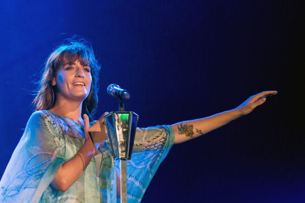 RIO DE JANEIRO, BRAZIL - SEPTEMBER 14: Florence Welch of Florence and the Machine performs on stage during a concert in the Rock in Rio Festival on September 14, 2013 in Rio de Janeiro, Brazil. (Photo by Buda Mendes/Getty Images)