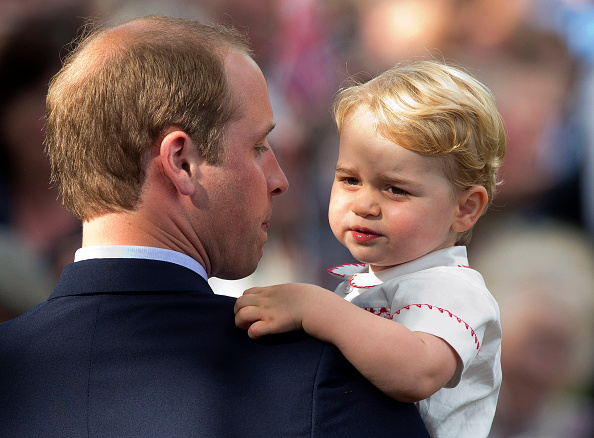 KING'S LYNN, ENGLAND - JULY 05: Prince William, Duke of Cambridge, holds Prince George of Cambridge as they leave the Church of St Mary Magdalene on the Sandringham Estate for the Christening of Princess Charlotte of Cambridge on July 5, 2015 in King's Lynn, England. (Photo by Matt Dunham - WPA Pool/Getty Images)
