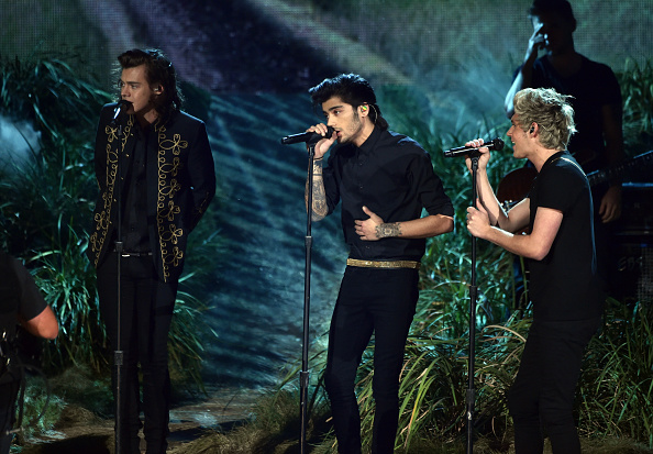 LOS ANGELES, CA - NOVEMBER 23: : (L-R) Singers Harry Styles, Zayn Malik and Niall Horan of One Direction perform onstage at the 2014 American Music Awards at Nokia Theatre L.A. Live on November 23, 2014 in Los Angeles, California.  (Photo by Kevin Winter/Getty Images)