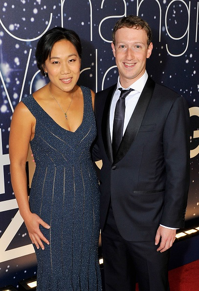 MOUNTAIN VIEW, CA - NOVEMBER 09:  Breakthrough Prize Founders Priscilla Chan and Mark Zuckerberg (R) attend the Breakthrough Prize Awards Ceremony Hosted By Seth MacFarlane at NASA Ames Research Center on November 9, 2014 in Mountain View, California.  (Photo by Steve Jennings/Getty Images for Breakthrough Prize)