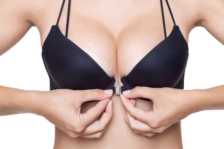 woman buttoning her black bra