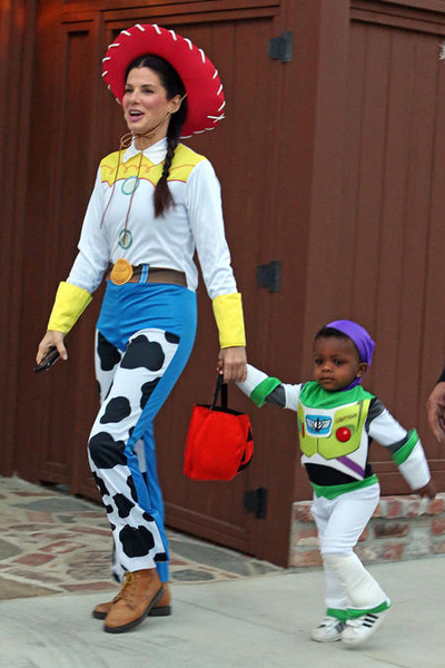 Dressed up as jessie and louis as buzz lightyear from the pixar movie