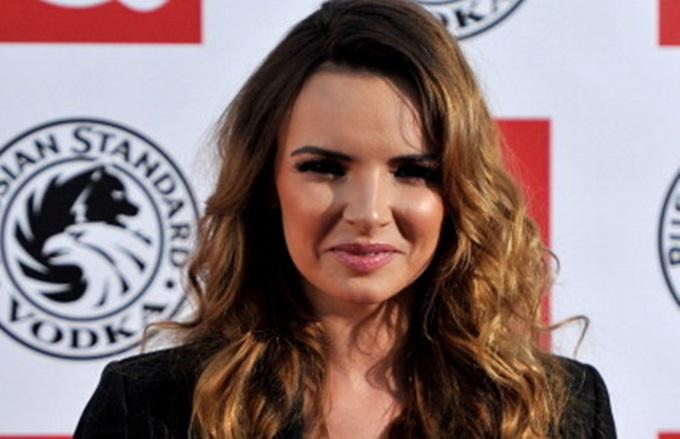 LONDON, ENGLAND - OCTOBER 25: Nadine Coyle arrives at the Q Awards 2010 at Grosvenor House Hotel on October 25, 2010 in London, England. (Photo by Gareth Cattermole/Getty Images)