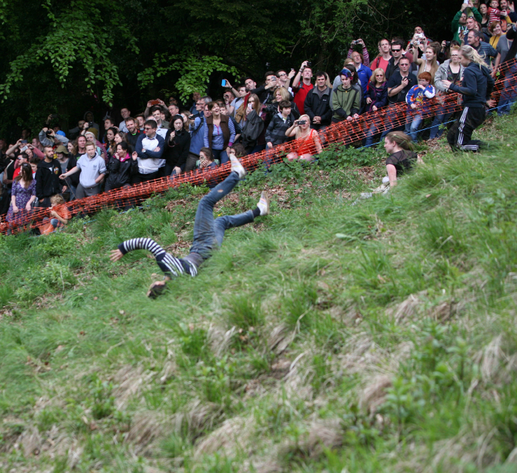 Woman faller at the 2015 Cheese Rolling event held in Gloucestershire, England