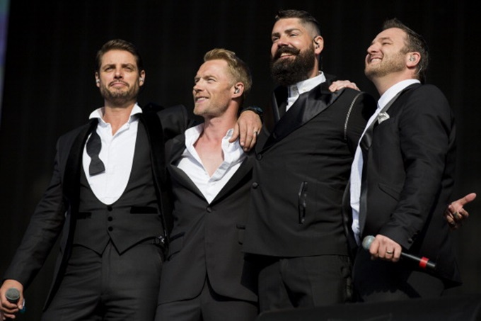 LONDON, ENGLAND - JULY 13: (L-R) Keith Duffy; Ronan Keating; Shane Lynch and Mikey Graham of Boyzone performs on stage at British Summer Time Festival at Hyde Park on July 13, 2014 in London, United Kingdom. (Photo by Tristan Fewings/Getty Images)