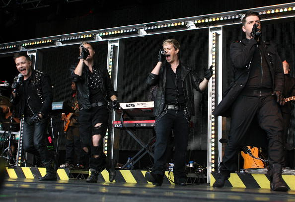 NEWBURY, ENGLAND - AUGUST 14 : Shane Filan, Nicky Byrne, Kian Egan and Mark Feehily of Westlife perform at Newbury racecourse on August 14, 2010 in Newbury, England (Photo by Jan Kruger/Getty Images)