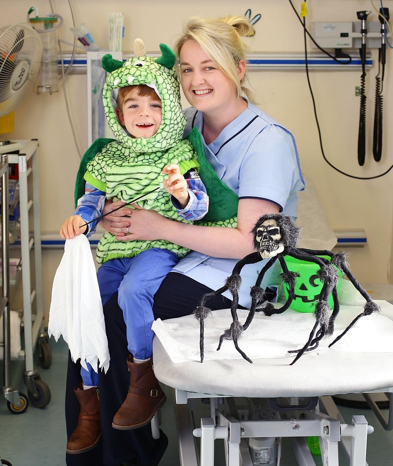 12/10/15*RERELEASED***NO REPRO FEE***Marcus Connors aged 4 from Clane in Co.Kildare pictured with nurse Caroline Clancy as Maia Dunphy launches Trick or Treat for Temple Street New Mum Maia brings the magic of Halloween to Temple Street as she is announced as the 2015 Trick or Treat Ambassador. Maia Dunphy today launched Trick or Treat for Temple Street, proudly supported by MiWadi, with help from some little patients in the busy childrenís hospital. As 2015 ambassador for the Halloween fundraiser, the wickedly funny TV presenter, writer and new mum is encouraging everyone ñ kids, adults, schools and work places  to host a spooky party and help Temple Street. See www.templestreet.ie for more information Pic: Marc O'Sullivan #TOT4TempleStreet