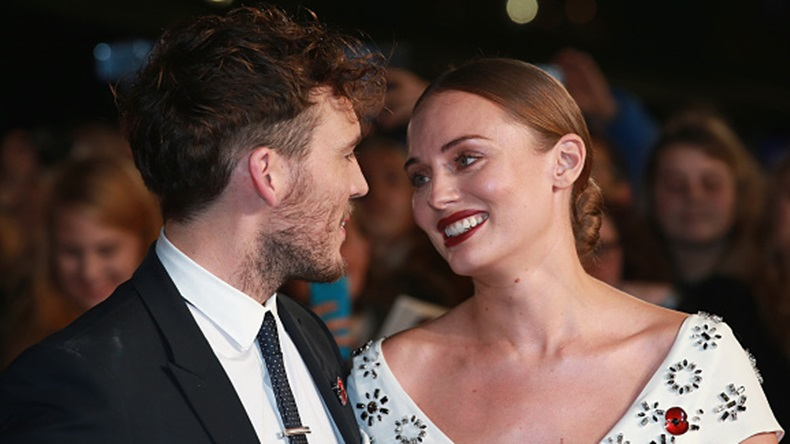 """LONDON, ENGLAND - NOVEMBER 05: Actor Sam Claflin and Laura Haddock attend """"The Hunger Games: Mockingjay Part 2"""" UK Premiere at the Odeon Leicester Square on November 5, 2015 in London, England. (Photo by Chris Jackson/Getty Images)"""