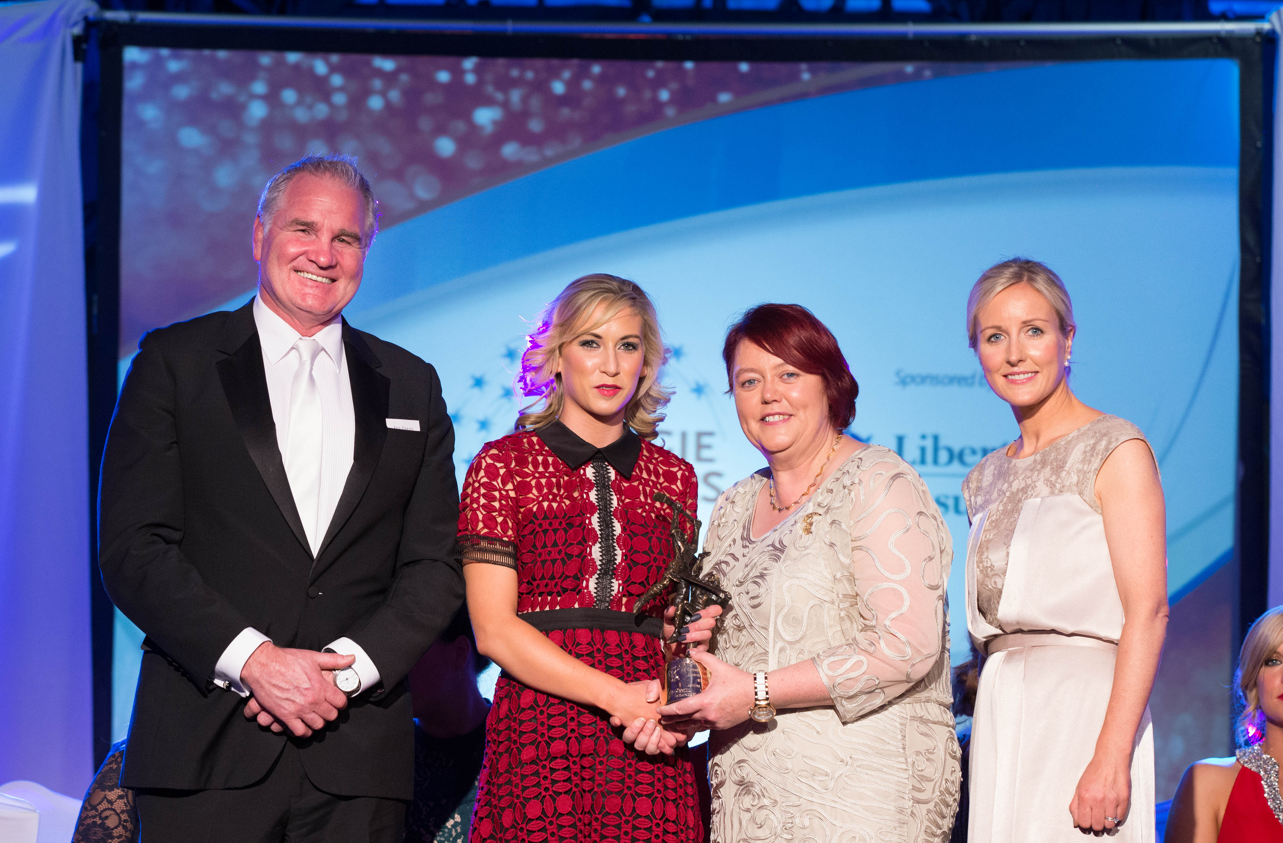 REPRO FREE***PRESS RELEASE NO REPRODUCTION FEE***  2015 Camogie All-Stars In Association With Liberty Insurance, Citywest Hotel, Dublin 7/11/2015  Niamh Kilkenny of Galway receives her Camogie All Star Award from Judy Mullane, Brand and Communications Manager, Liberty Insurance, Catherine Neary, President of the Camogie Association, and special guest Brent Pope Mandatory Credit ©INPHO/Cathal Noonan