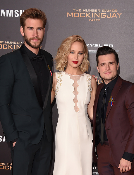 LOS ANGELES, CA - NOVEMBER 16: (L-R) Actors Liam Hemsworth, Jennifer Lawrence, and Josh Hutcherson attend the premiere of Lionsgate's 'The Hunger Games: Mockingjay - Part 2' at Microsoft Theater on November 16, 2015 in Los Angeles, California. (Photo by Jason Merritt/Getty Images)