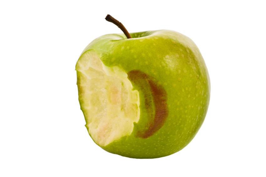 green apple on a white background with a kiss mark
