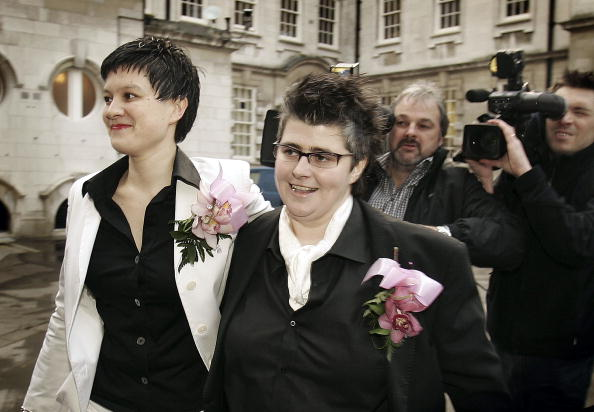BELFAST, UNITED KINGDOM - DECEMBER 19:  Grainne Close (R) and Shannon Sickels pose for photographers after becoming the United Kingdom's first gay couple to marry in a civil partnership on December 19, 2005 in Belfast, Northern Ireland.  The Civil Partnership Act 2004 came into law in the UK on December 5th, 2005  and hundreds of same sex partners have already registered for the ceremony.   (Photo by Peter Macdiarmid/Getty Images)