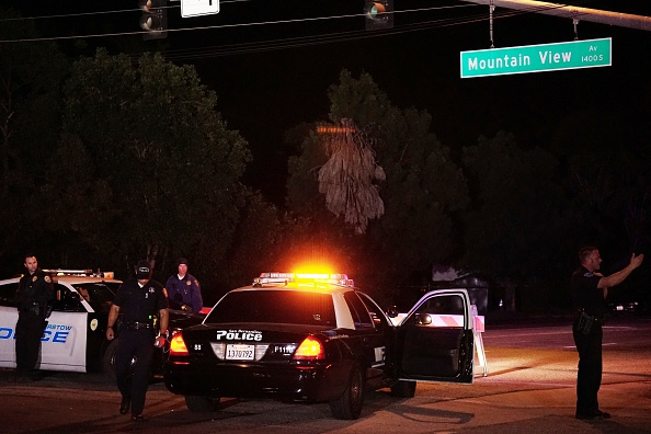 SAN BERNARDINO, CA - DECEMBER 02: Barstow police officers stand guard as they investigate the crime scene on December 2, 2015 in San Bernardino, California. Two suspects in a deadly mass shooting that killed 14 victims at a social services facility in California were killed after a confrontation with police, authorities said Wednesday. The initial shooting occurred earlier Wednesday when at least one shooter opened fire in San Bernardino at the Inland Regional Center, which provides services to persons with developmental disabilities and their families. At least 17 others were injured. (Photo by Mintaha Neslihan Eroglu/Anadolu Agency/Getty Images)