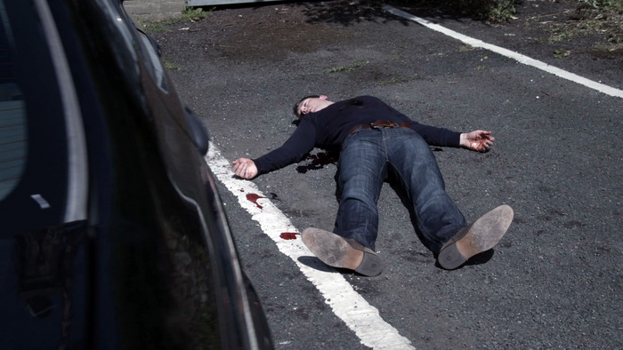 **** Strictly embargoed until 9pm on Wednesday 30th December, 2015 **** Episode 80 (airs Thurs 31st Dec) Superintendent James McKay is stabbed outside the Garda station - In Picture: James McKay played by Richard Flood. Superintendent James McKay becomes the first major character to meet his maker in Red Rock. In dramatic and heart wrenching scenes, Superintendent James McKay is stabbed to death as he exits his car, intent on finally, but reluctantly, exposing Paudge for his part in feeding Beady Burke confidential Garda intelligence. As McKay approaches the Garda station a hooded figure appears and stabs him in the stomach. Despite the trouble he finds himself in with the Super, Paudge runs to McKay's defence but he too is stabbed in the process and left fighting for his life. As Paudge manages to stumble towards the station for help, it soon becomes apparent that McKay is fighting for his life on the opposite side of the road. In what must be one of the most emotional scenes filmed to date, we witness McKay slip away in the arms of his wife Claire. With McKay gone, will the truth about Paudge be buried with him, or will the guilt drive Paudge to confess everything to Detectives Nikki Grogan and Rory Walsh? Red Rock airs every Wednesday and Thursday at 8.30pm on TV3