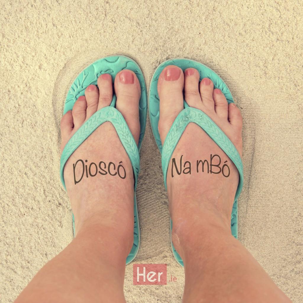 Selfie of woman feet wearing flip flops on a beach, vintage process