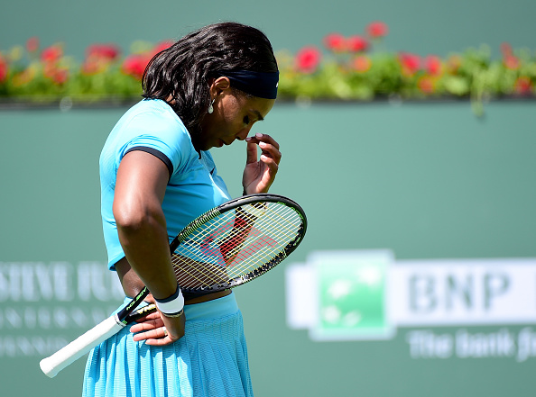 INDIAN WELLS, CA - MARCH 20: Serena Williams of the United States reacts after a lost point as she loses to Victoria Azarenka of Belarus in the WTA Singles Final during day fourteen of the 2016 BNP Parisbas Open at Indian Wells Tennis Garden on March 20, 2016 in Indian Wells, California. (Photo by Harry How/Getty Images)