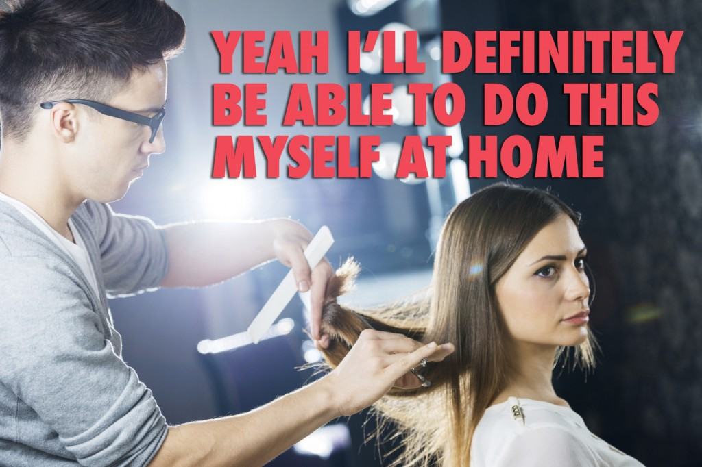 Hairdresser cutting his customer's hair.