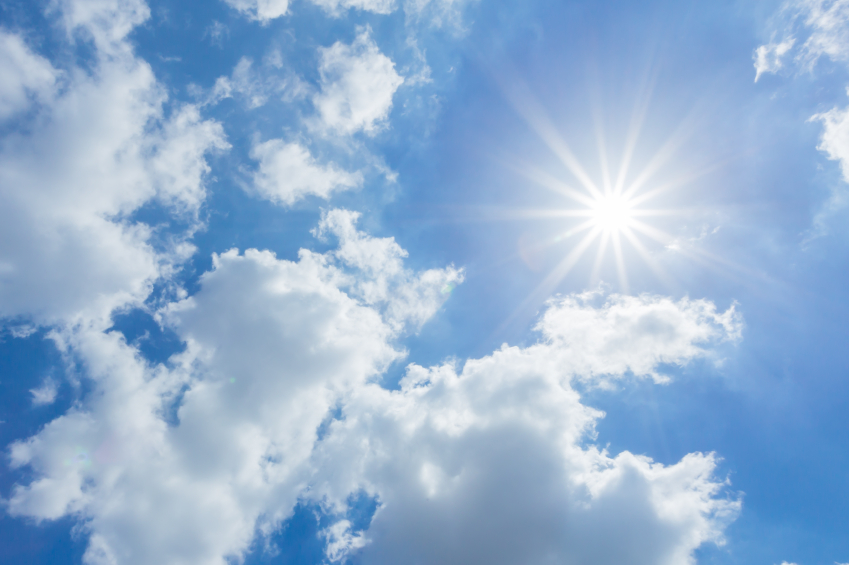 The sun shines bright in the daytime in summer. Blue sky and clo