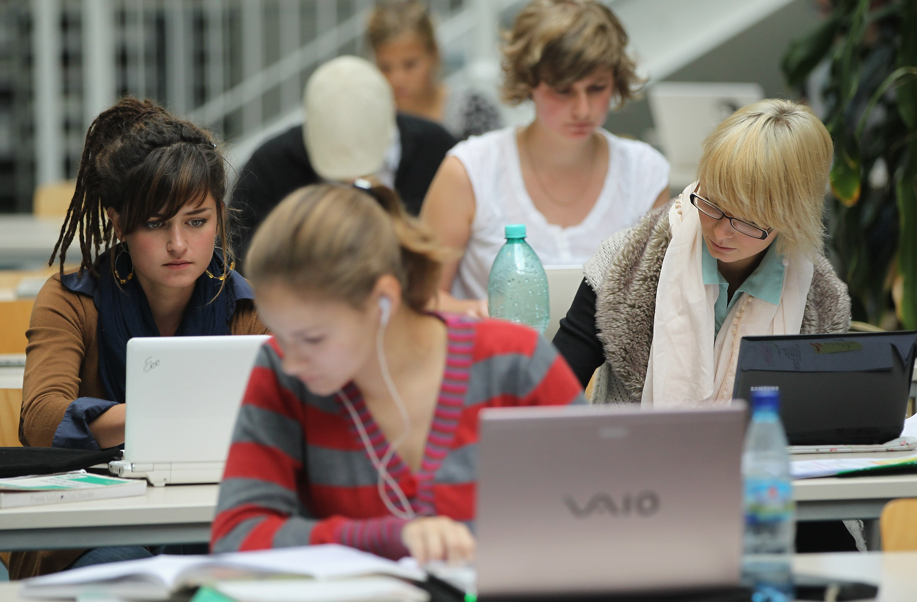 BERLIN, GERMANY - SEPTEMBER 20: Students study with their laptop computers in the Pedagogical Library at the Freie Universitaet university on September 20, 2011 in Berlin, Germany. German universities recorded a record 2.218 million matriculations in the 2010/2011 winter semester, a rise of 4.5%, and expect even more students in the coming winter semster, which starts in October. The end of compulsory military service in the Bundeswehr, the German armed forces, which went into effect earlier this year, is a major contributing factor to the rise in the numbers of students arriving at universities across the country. (Photo by Sean Gallup/Getty Images)