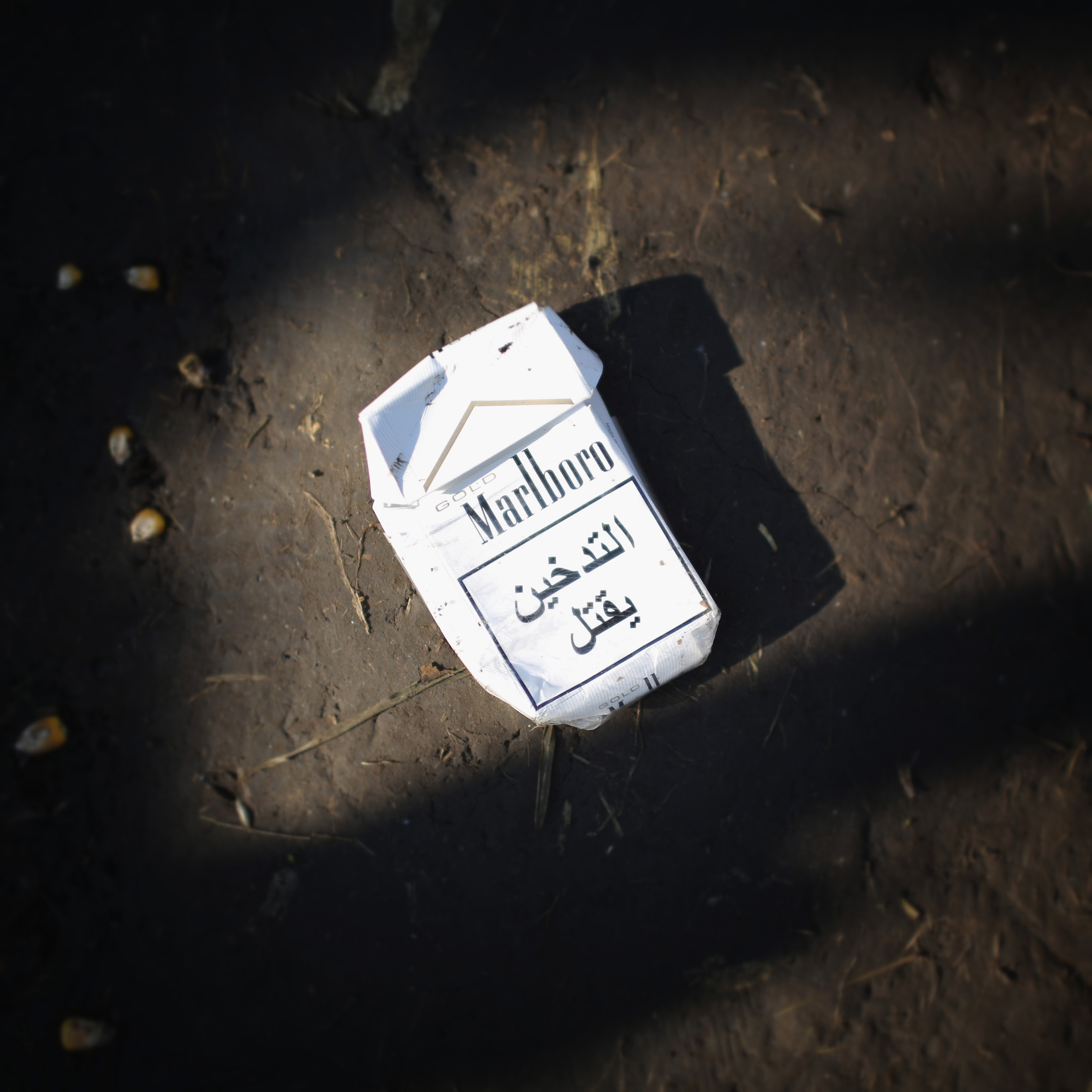 ROSZKE, HUNGARY - SEPTEMBER 14: (EDITOTS NOTE: This image was processed with digital filters) An empty packet of foreign cigarettes lays on the ground as migrants discard items no longer wanted or needed when they cross the Hungarian border on September 14, 2015 in Roszke, Hungary. Since the beginning of 2015 the number of migrants using the so-called 'Balkans route' has exploded with migrants arriving in Greece from Turkey and then travelling on through Macedonia and Serbia before entering the EU via Hungary. As the migrants converge on the small gap in the border fence of the Hungarian-Serbian border they discard items that they are too tired to carry or no longer need. Many shoes litter the tracks as they replace them with shoes donated by the public. Forms of identity are also ripped up and discarded along with tents, sim cards and blankets. (Photo by Christopher Furlong/Getty Images)