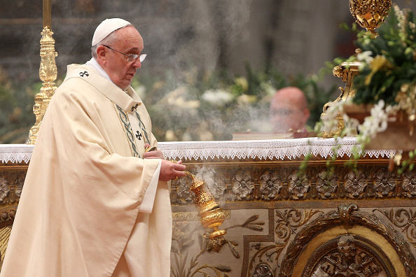 VATICAN CITY, VATICAN - JANUARY 06: Pope Francis blesses the alter with incense during the Epiphany Mass at St. Peter's Basilica on January 6, 2015 in Vatican City, Vatican. During his homily, the Pope Francis focused on the journey taken by the three wise men, which is celebrated today, and encouraged Catholics to keep a strong faith. (Photo by Franco Origlia/Getty Images)