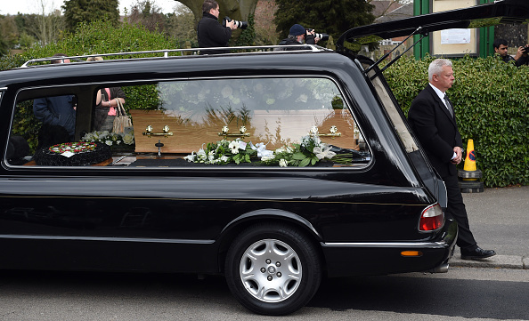 SHIRLEY, ENGLAND - APRIL 18: Ronnie Corbetts coffin departs his funeral on April 18, 2016 in Shirley, England. Ronnie Corbett best known for BBC comedy sketch show The Two Ronnies, died aged 85. (Photo by Stuart C. Wilson/Getty Images)