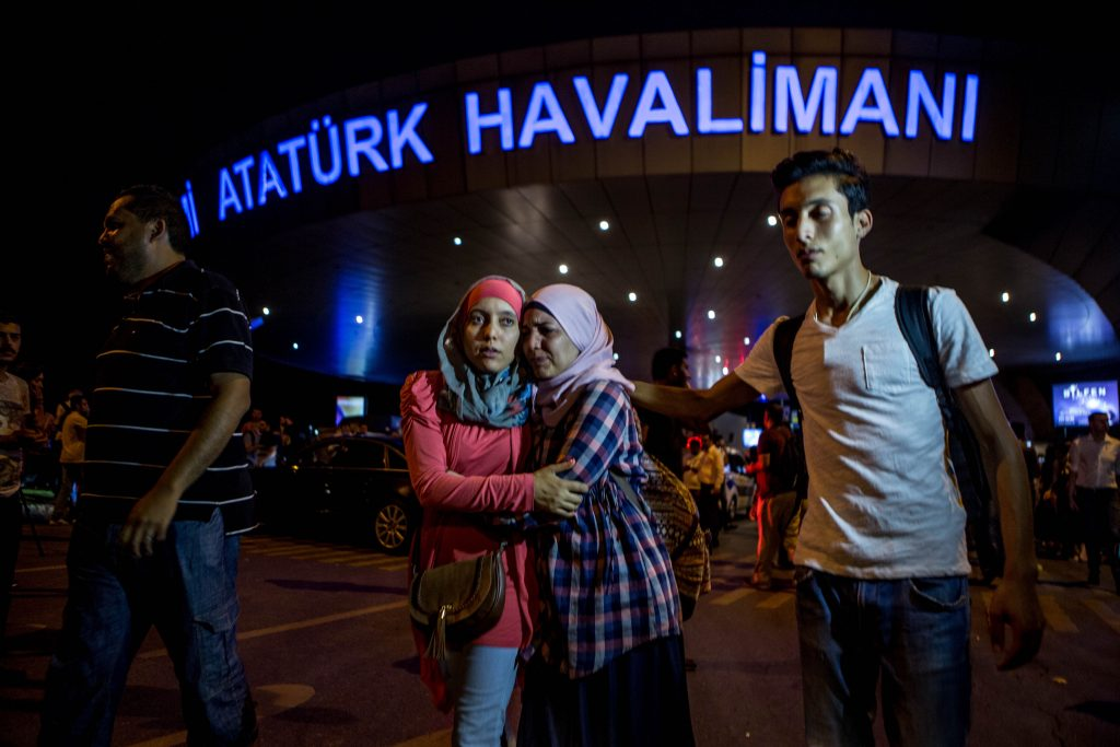 ISTANBUL, TURKEY - JUNE 29: Passengers leave Istanbul Ataturk, Turkey's largest airport, after a suicide bomb attack in the early hours of June 29, 2016, Istanbul, Turkey. Three suicide bombers opened fire before blowing themselves up at the entrance to the main international airport in Istanbul, killing at least 28 people and wounding at least 60 people according to Istanbul governor Vasip Sahin. (Photo by Defne Karadeniz/Getty Images)
