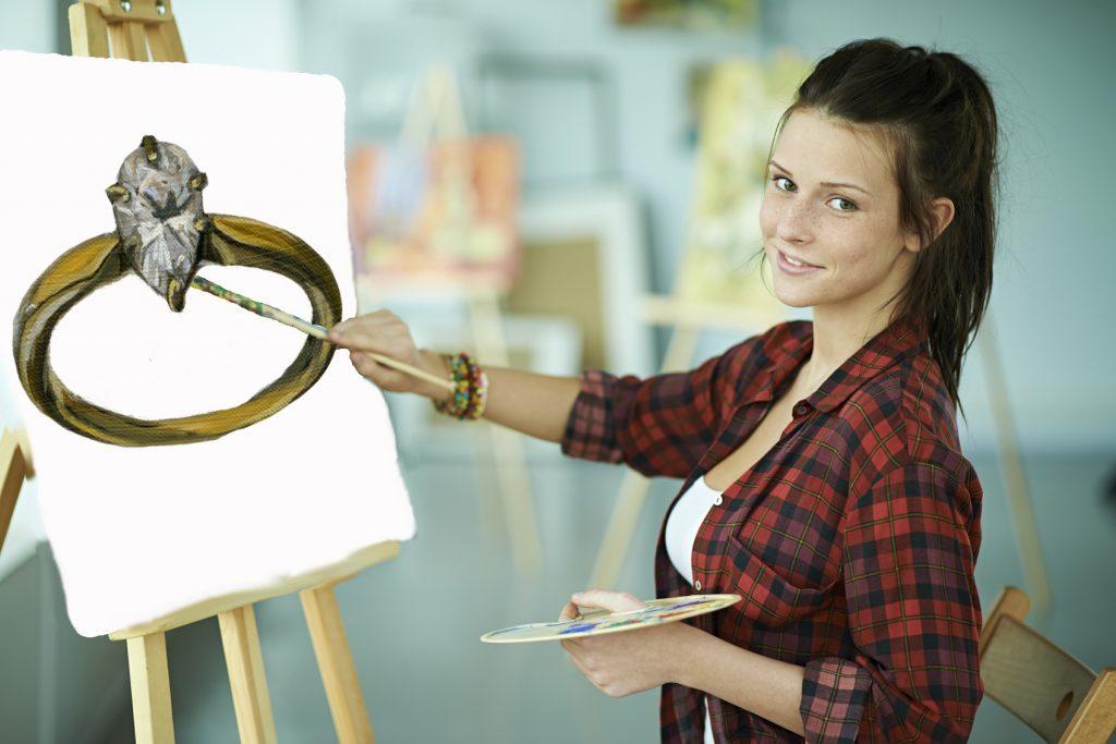 Young woman drawing still-life