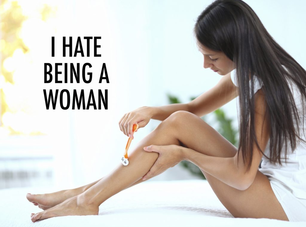 Side view of woman shaving her legs with a razor.