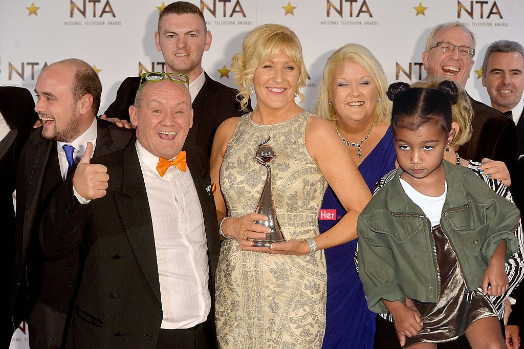 LONDON, ENGLAND - JANUARY 21: Jennifer Gibney and Brendan O'Carroll pose with cast members in the winners room with the Best Comedy Award for Mrs Brown's Boys at the National Television Awards at 02 Arena on January 21, 2015 in London, England. (Photo by Anthony Harvey/Getty Images)