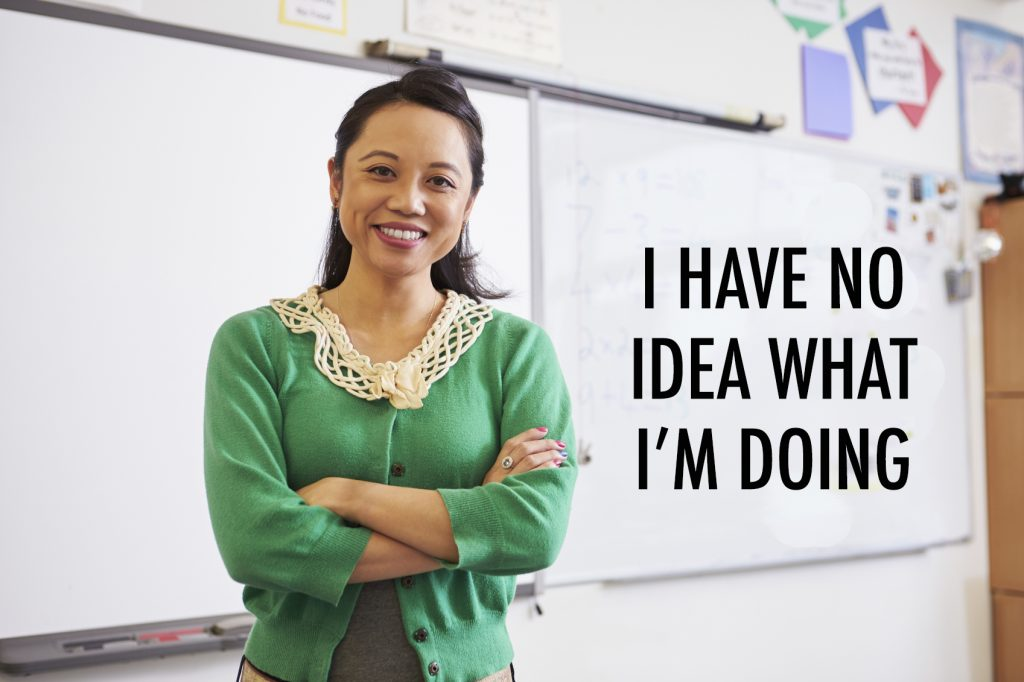 Portrait of confident Asian female teacher in classroom