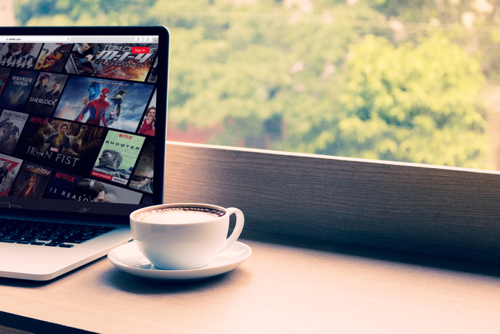 NetflixChiang Mai: Netflix website showing on screen laptop with macbook pro at cafe. Netflix being popular internationally