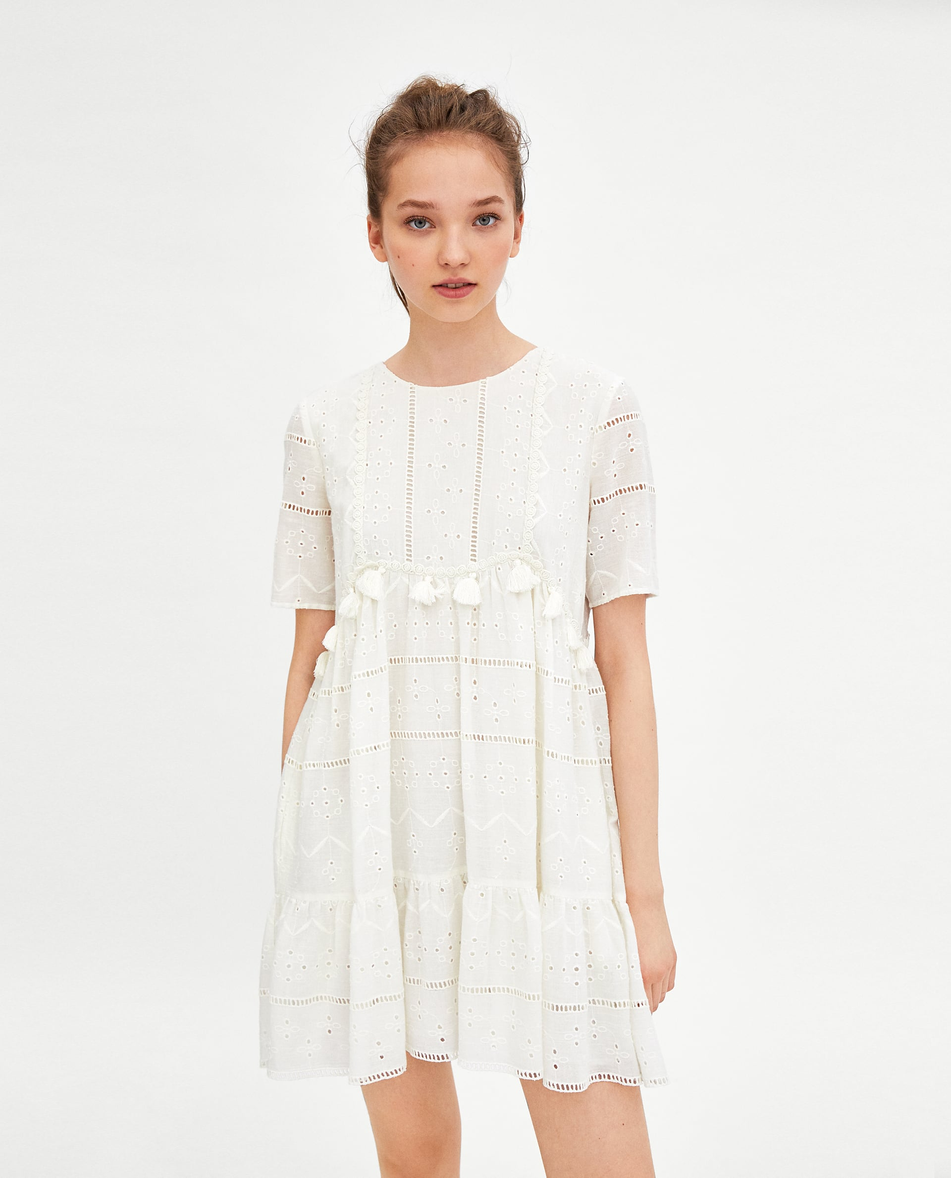 We have found the perfect white summer dress and its 40 from zara this light embroidered white dress with tassels is perfect for throwing over a bikini or dressing up with a glam sandal heel and drop earrings for a late mightylinksfo