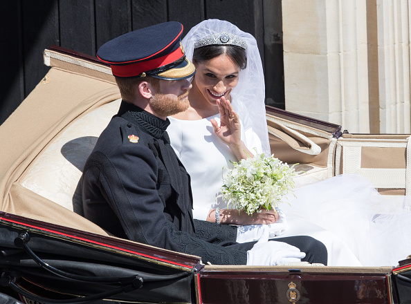 Sorry, what? Turns out Harry got a glimpse at Meghan's wedding look before their big day