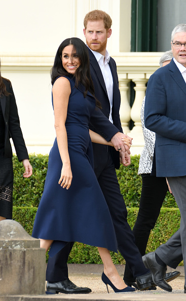 Meghan's taking a rare step outside her normal wardrobe today and we're loving it