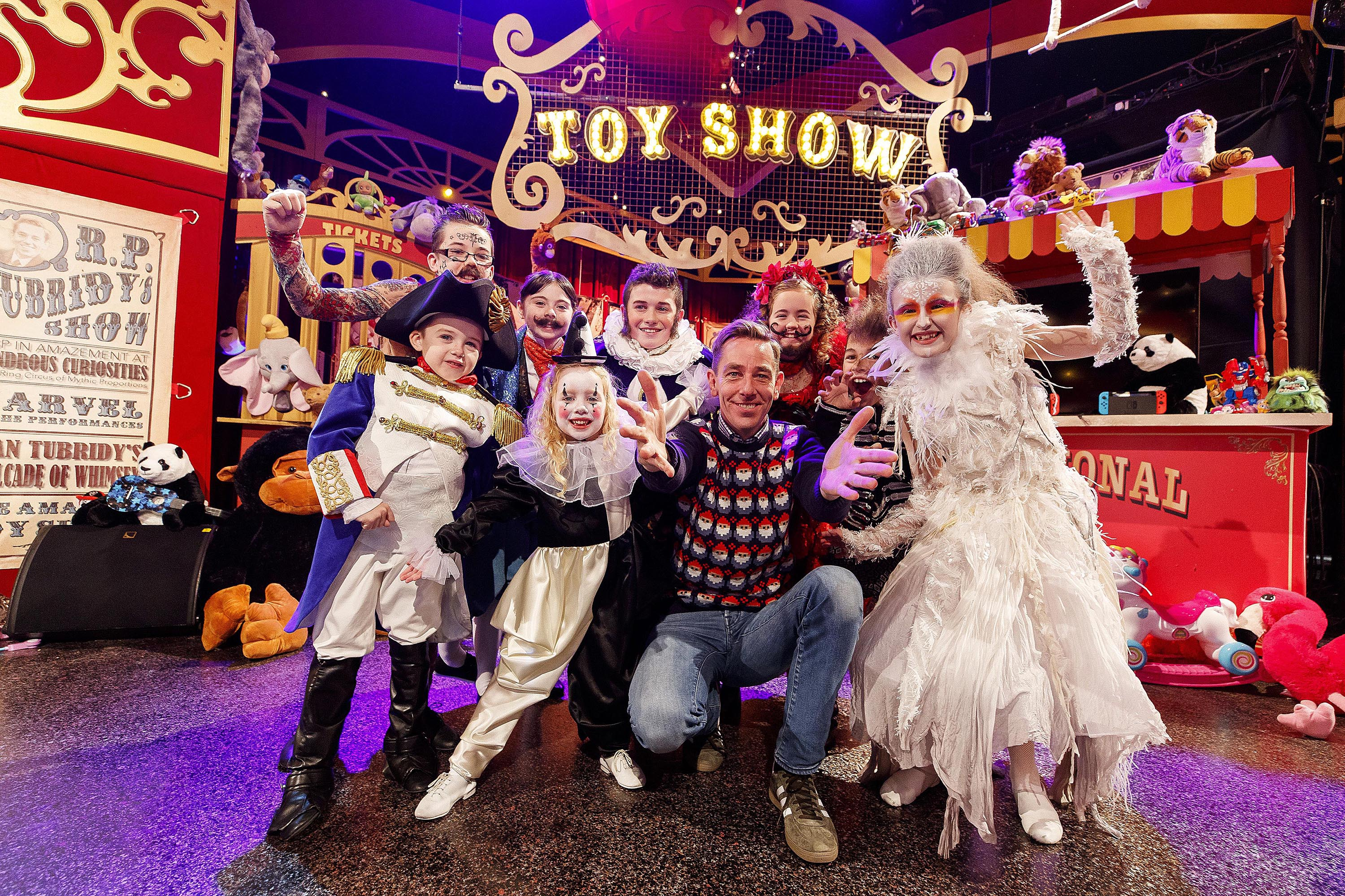 ***Embargoed untill 30/11/2018*** Repro Free: 29/10/2018 The theme of this year's Late Late Toy Show was revealed to be The Greatest Showman. Host Ryan Tubridy and the cast of hundreds have prepared for the most magical night of the Irish television. Pictured with Ryan are some of the cast Tatto Man Dylan Allen (5) from Navan, Napoleon Luke O'Connor (7) from Dublin, 3-Legged Man Kayla McMahon (10) from Balrothery, Pierrot clown enya Allen (5) from Navan, Fatman Mathew Little (12) from Dublin, Bearded Lady, Alannah Willoughby (12) from Carlow and Wolf Man Colm O'Sullivan 98) from Navan, Albino Ella Maher (10) from Carlow. Picture Andres Poveda