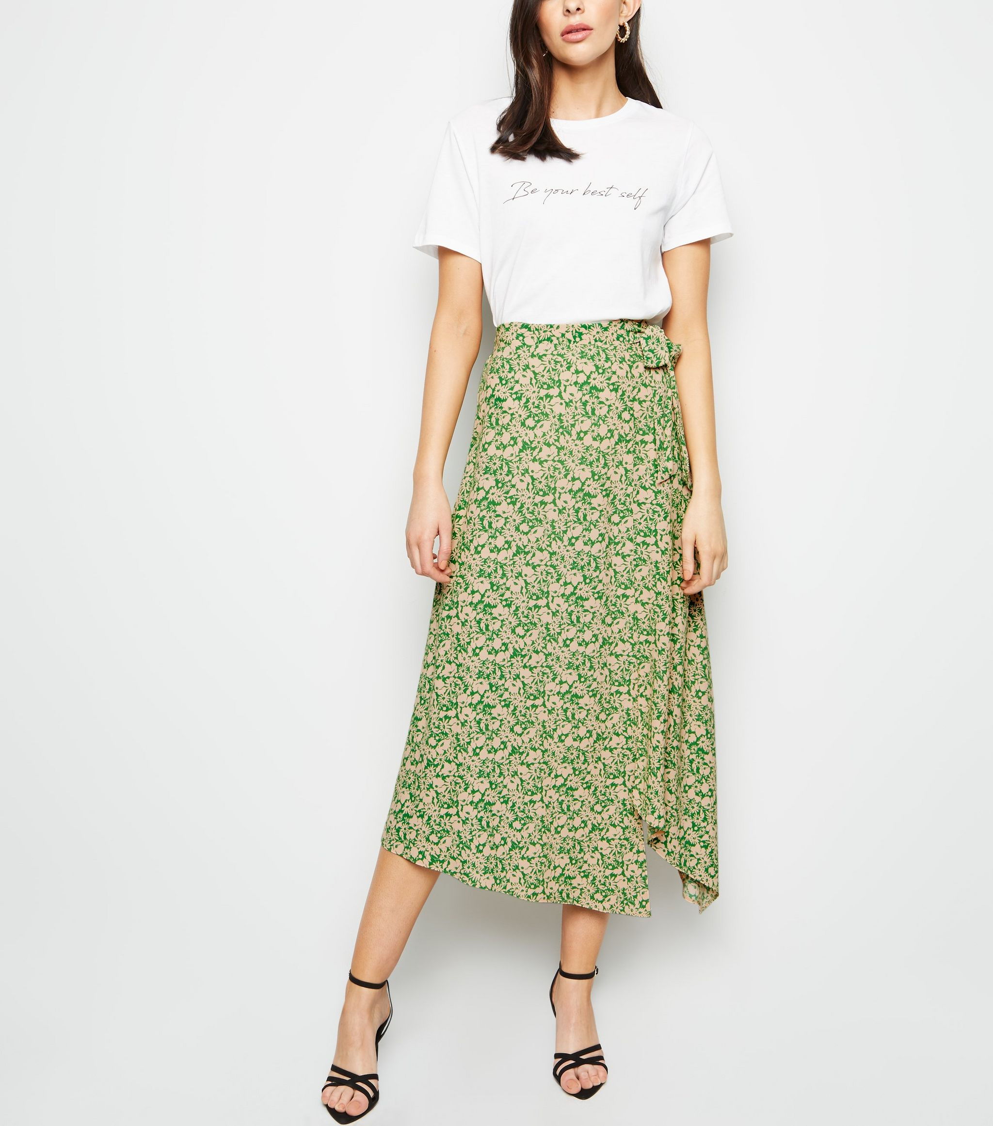 421cfbca5 At €25, the green ditsy floral midi-skirt looks so much more expensive than  it actually is - and is one of those pieces we know we'll be reaching for  again ...