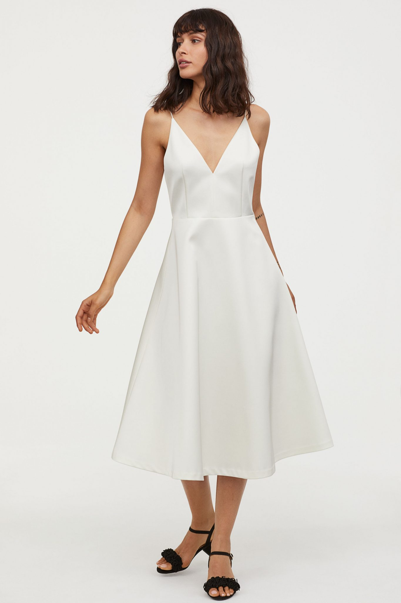 81836dbb58c6 Our favourite dress they have though is the ultra-modern cream one with a  flared skirt.