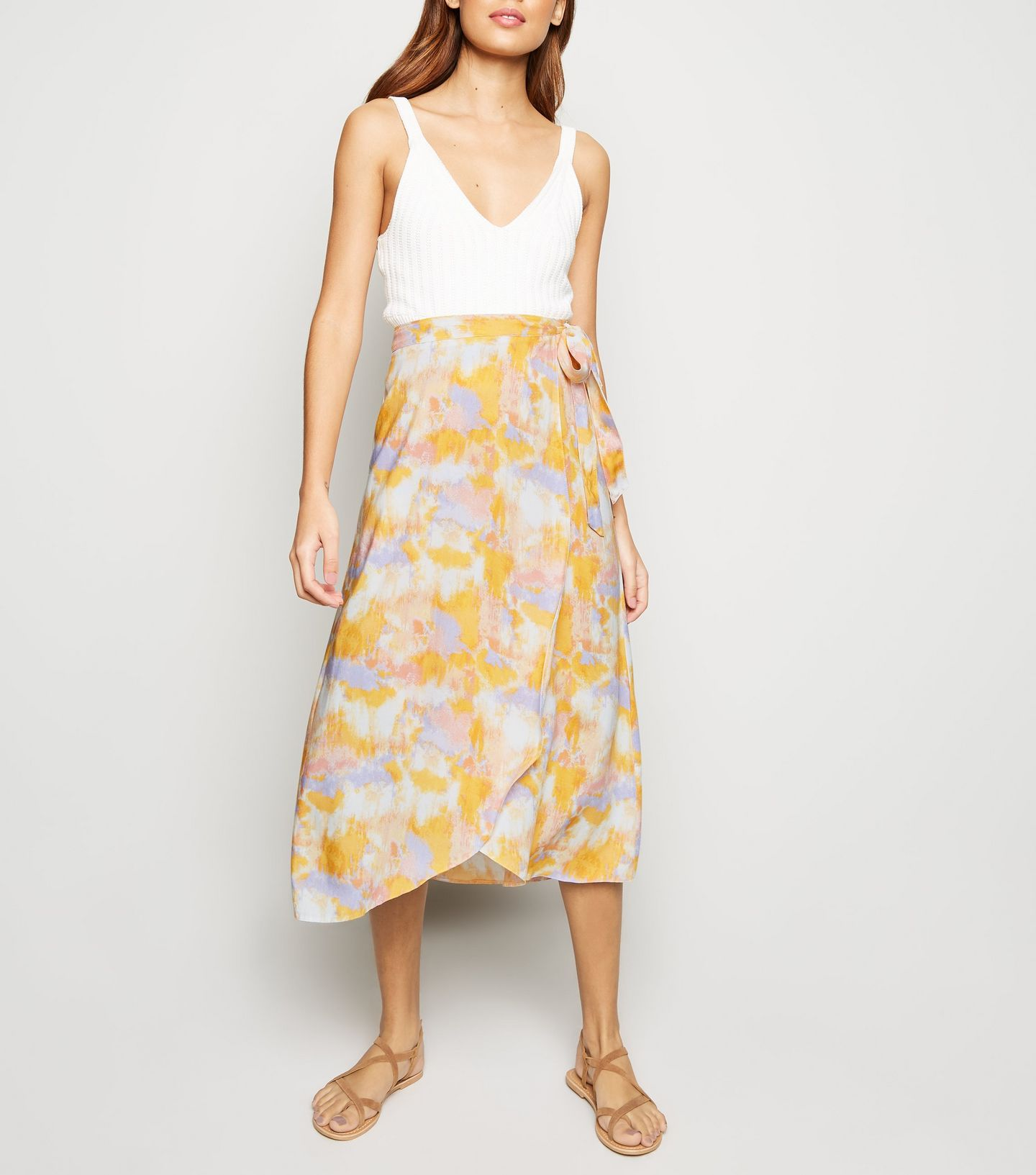 2a10a767638d ... this €22.99 white tie dye wrap midi-skirt - which we just know is going  to be be one of those pieces we'll be reaching for again and again this  spring.